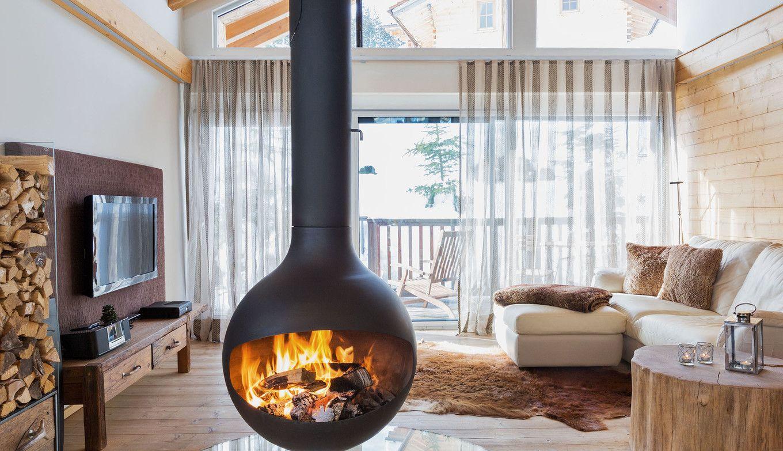 Luxuslodge Wohnzimmer mit Ofen im Winter